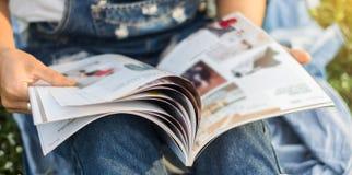 Reading a magazine blur Stock Photo