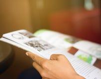 Reading a magazine blur. Woman reading a magazine blur in garden Stock Photo