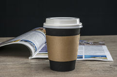 Reading magazine and drinking coffee Royalty Free Stock Photography