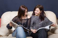 Reading magazines Stock Images