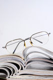 Reading magazines Stock Images