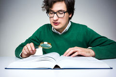 Reading with magnifier Stock Photos