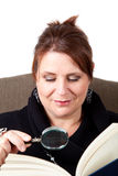 Reading with Magnifying Glass Royalty Free Stock Image