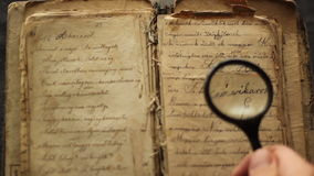Reading with magnifying glass. stock video footage