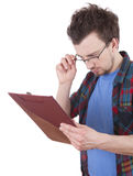 Reading male student wiith clipboard. White background Royalty Free Stock Image