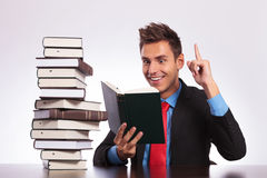 Reading man has an idea at desk Royalty Free Stock Photo