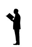 Reading man silhouette with clipping path. Reading man silhouette over white Royalty Free Stock Image