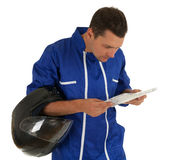 Reading map motorcyclist Stock Image