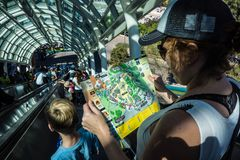 Reading Map for Universal Studios. Crowds navigate the steep hills of Universal Studios, California by way of a long series of escalators. The moving stairs hug Stock Images
