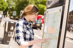 Reading map. Young woman reading a map Stock Images