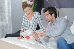 Reading the mattress description. Boutique royalty free stock photography