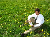 Reading on the Meadow. The student is reading on the lawn Royalty Free Stock Photo