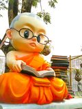 Reading monk. Statue with many books Royalty Free Stock Images