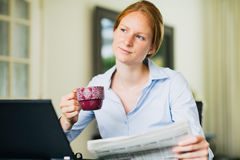 Reading Morning News Over Coffee Stock Photo