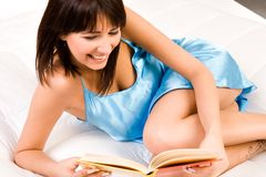 Reading in my bed stock images