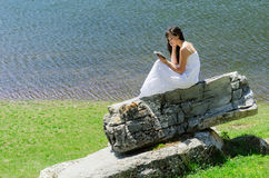 Reading in Nature. Woman reading a book in nature Stock Photography