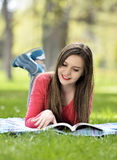 Reading in nature is my hobby Royalty Free Stock Image