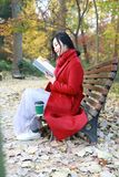 Reading in nature is my hobby, girl Read  book sit bench Stock Images