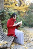 Reading in nature is my hobby, girl Read  book sit bench Royalty Free Stock Photography