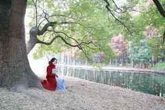 Reading in nature is my hobby, girl Read  book sit under big tree Royalty Free Stock Photography