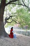 Reading in nature is my hobby, girl Read  book sit under big tree Royalty Free Stock Images