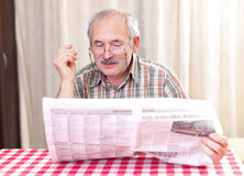 Reading the news Royalty Free Stock Photo