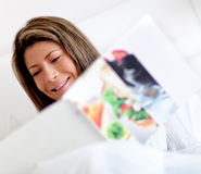 Reading the news in bed Stock Image