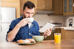Reading the news during breakfast Stock Image