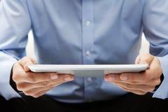 Reading news at digital tablet Royalty Free Stock Photos