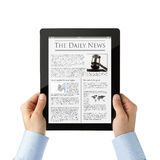 Reading news at digital tablet Stock Photos
