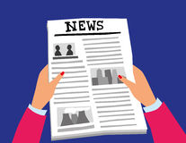Reading the News Page Royalty Free Stock Photo