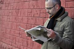 Reading newspaper. This picture represents a man reading newspaper Royalty Free Stock Image