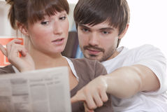 Reading newspaper Stock Photography