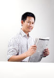 Reading newspaper Royalty Free Stock Image