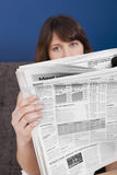 Reading the newspaper Royalty Free Stock Image