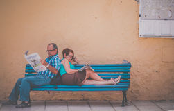Reading newspaper on the bench Royalty Free Stock Image
