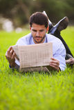 Reading the newspaper Stock Image