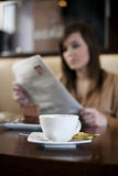 Reading newspaper in cafe. Woman reading newspaper in cafe Royalty Free Stock Photo