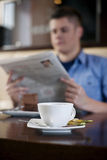 Reading newspaper in cafe. Man reading newspaper in cafe Royalty Free Stock Photography