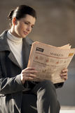 Reading newspaper outdoors Royalty Free Stock Photography
