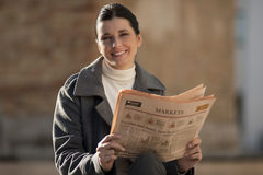 Reading newspaper outdoors Royalty Free Stock Photo