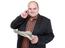 Reading newspaper and phoning Royalty Free Stock Photos