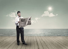 Reading a newspaper Royalty Free Stock Photos