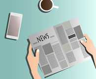 Reading newspaper on table stock photos