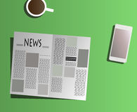 Reading newspaper on table Royalty Free Stock Photos