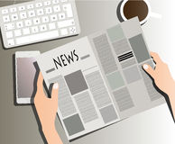 Reading newspaper on table Royalty Free Stock Images