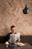 Reading newspaper Royalty Free Stock Images