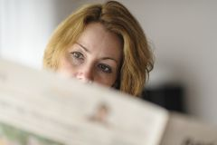 Reading a newspaper Stock Photo