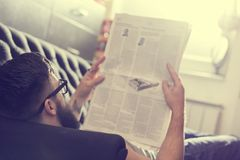 Reading newspapers Stock Image