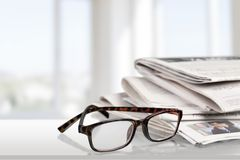 Reading Newspapers Stock Photos